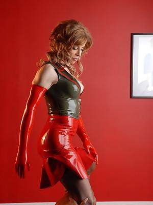 Beautiful Jasmine Jewels posing in irresistible latex costume